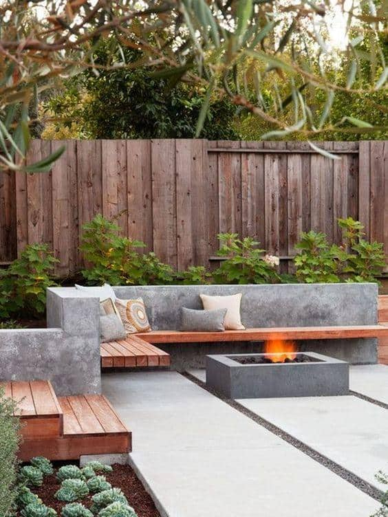 wooden fence and stone fire pit