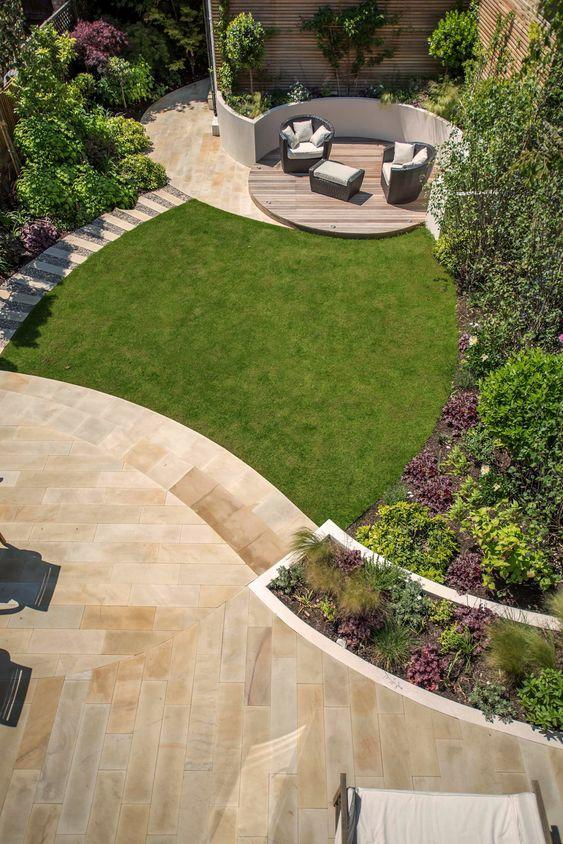 Contemporary Family Garden with circular patio and furnitire