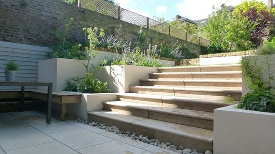 Ivory stone garden stairs with flower beds