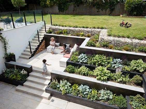 A three-level garden: add raised beds, a lawned area and a patio with seating