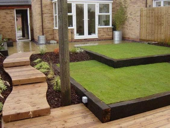 Another modern looking garden with artificial grass and railway sleepers