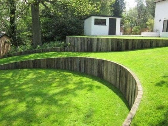 Retaining wall creating a two-level backyard.