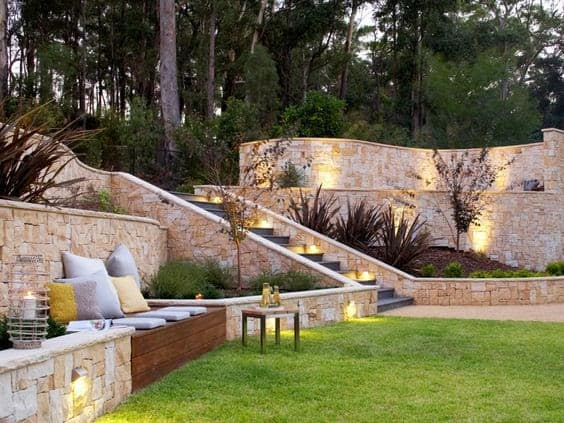 High retaining walls with lighting and outdoor seating