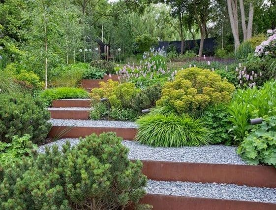 steep sloped garden by adding stairs and tiered planters, giving off a simple-look garden