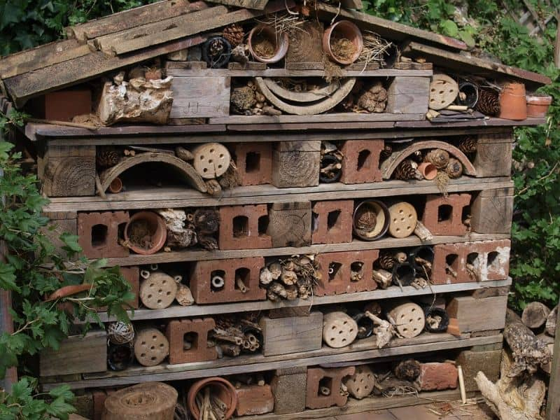 bug hotel with apex roof and brick sections