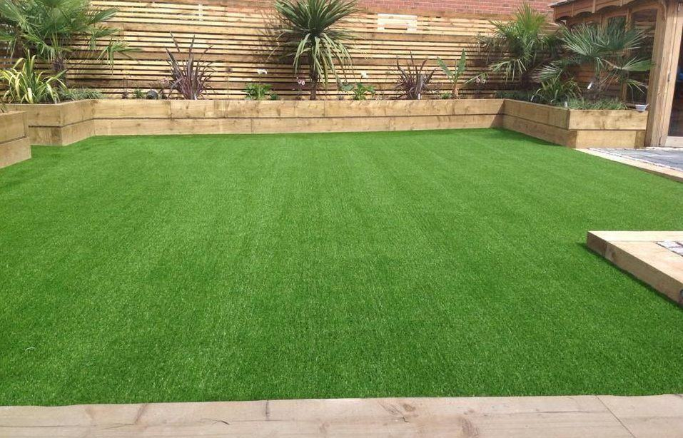 Timber and artificial grass combined in one garden