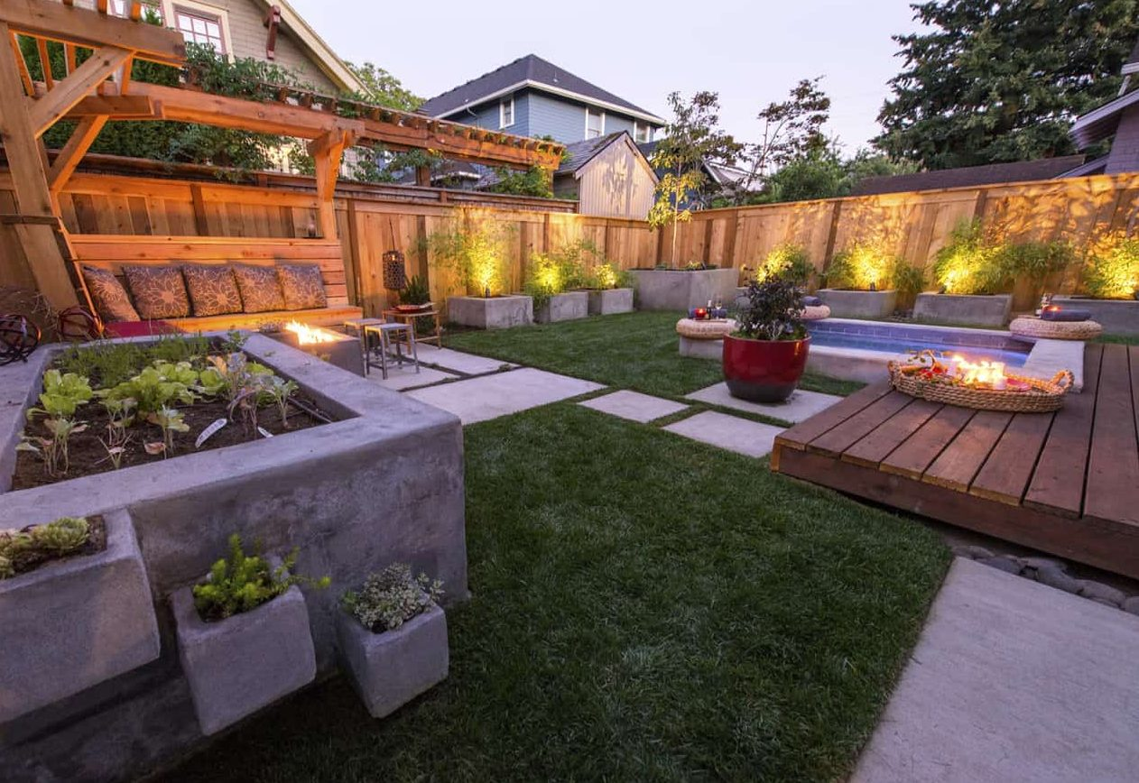 A garden with fire pit and garden beds