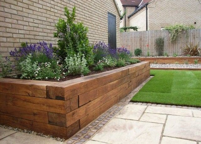 Side garden beds made from wooden material
