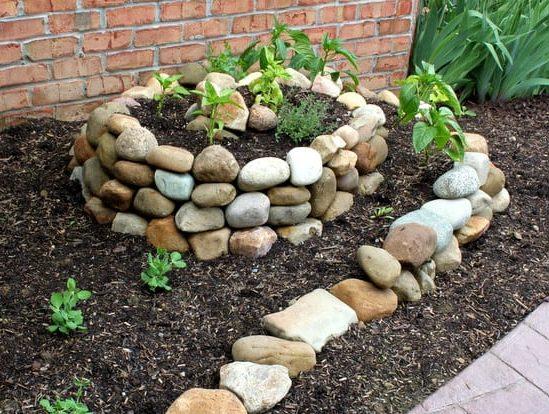 Spiral garden beds made of stones