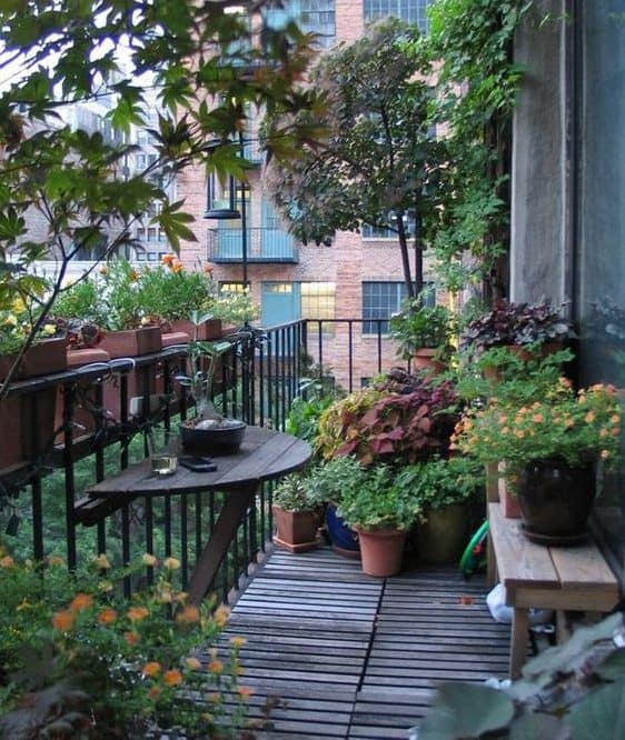Adorable balcony with wooden flooring