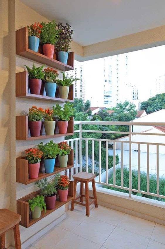 Coloured pots in floating shelves