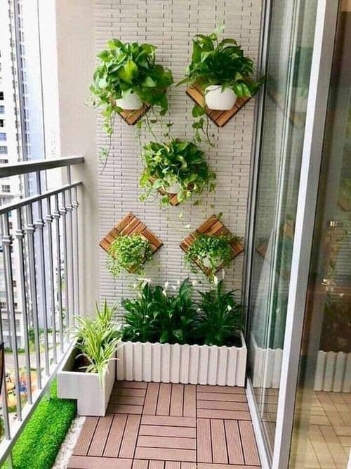 Small garden beds in the corner of a balcony