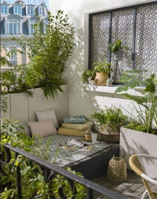 A modern, comfy seating spot, surrounded by plants