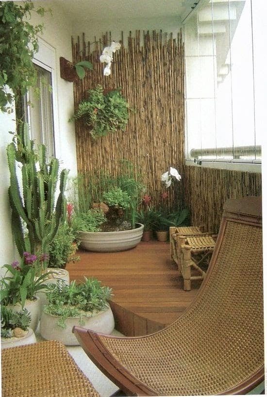 Bamboo sticks sprucing up the plain walls of a balcony