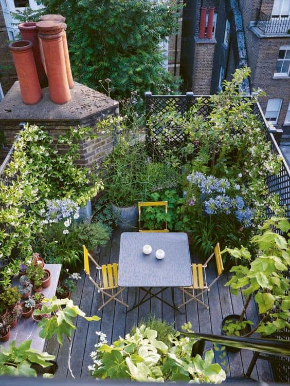 Small roof garden surrounded by beautiful plants and flowers