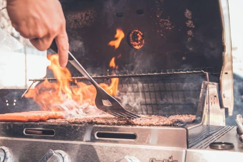 High flames on a burner BBQ grill