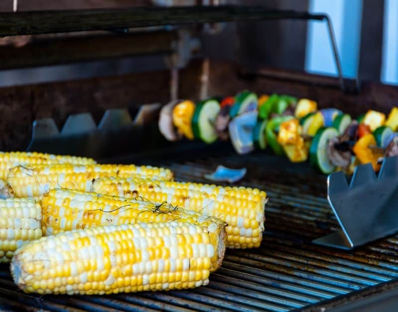 Corn and vegetable kebabs on BBQ grill