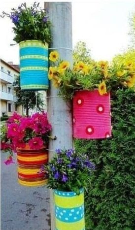 DIY old cans turned into colourful flower pots