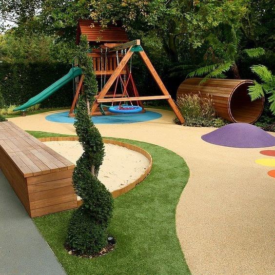 Grass and pebbles backyard playground