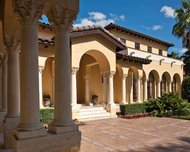 large Mediterranean-style villa with courtyard and hedges