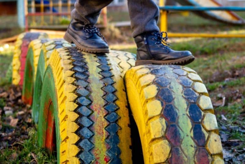 DIY tyre hedges with someone walking on them