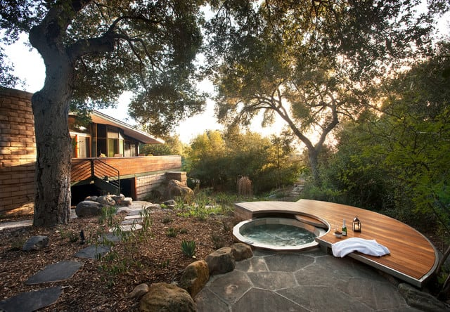 A garden hot tub with a 360 degree view of the forest and the property
