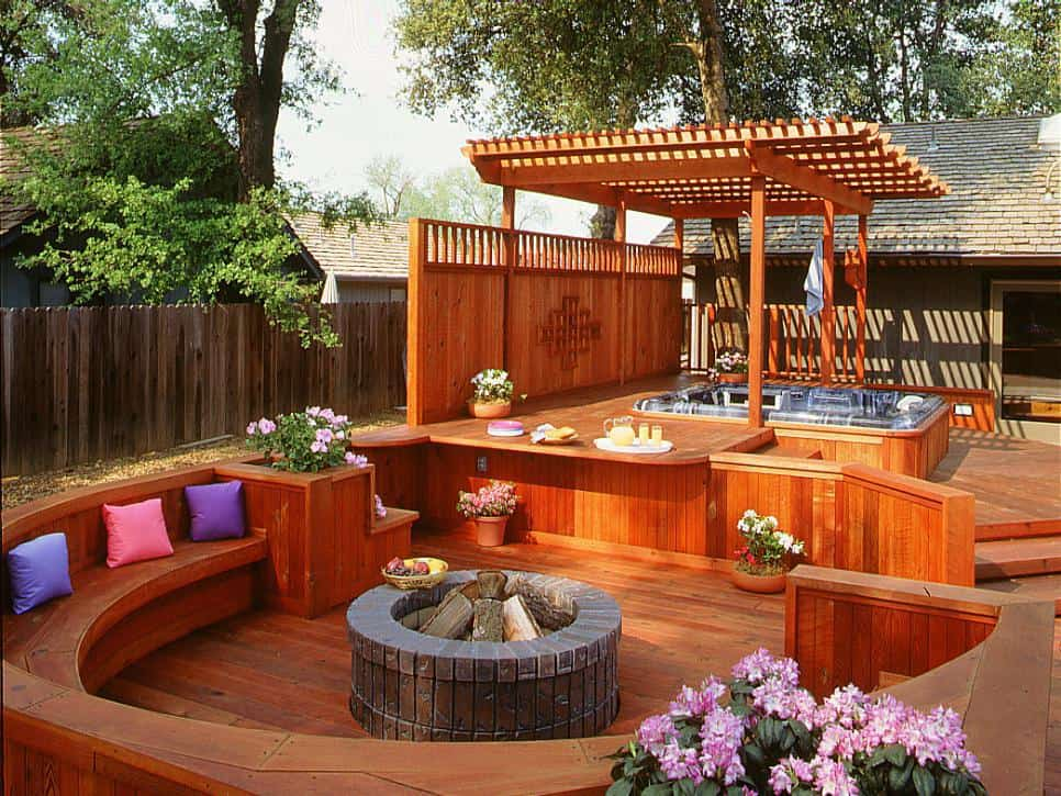 Raised short deck with accent seating around a circular firepit