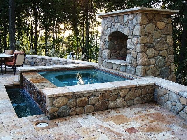 Travertine and black stone hot tub