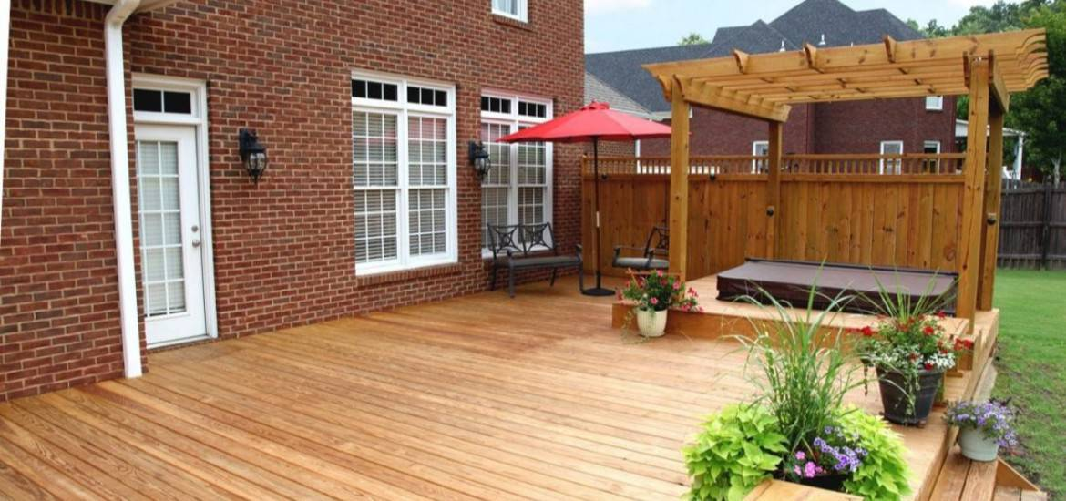A large wooden deck for an outdoor hot tub