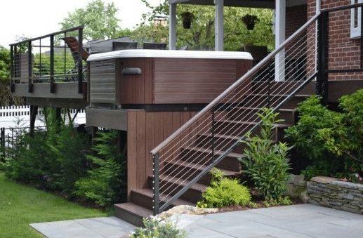 A hot tub deck with a raised platform concept