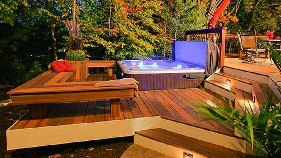 Tiered decks that create divided zones for living spaces, including for hot tub