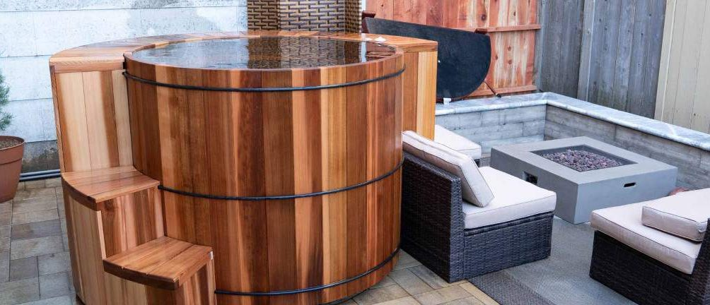 Oversized cedar hot tub with a stone fire pit