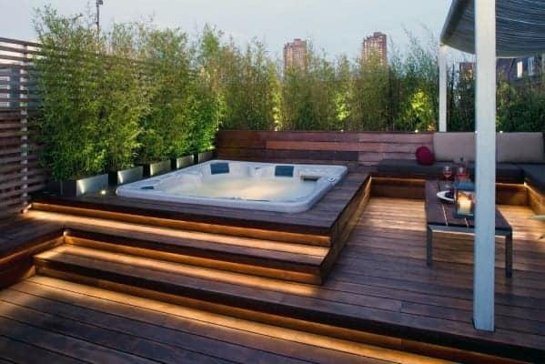 raised hot tub with footlights on deck