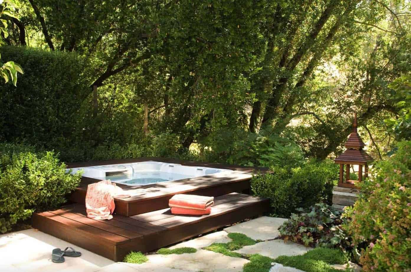 Hot tub deck combined with a landscape, adding natural privacy barrier