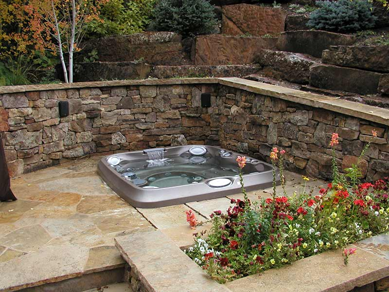 Faux stone concept hot tub area