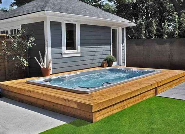 A bench surrounding the hot tub, giving off a nice clean, modern look and functionality