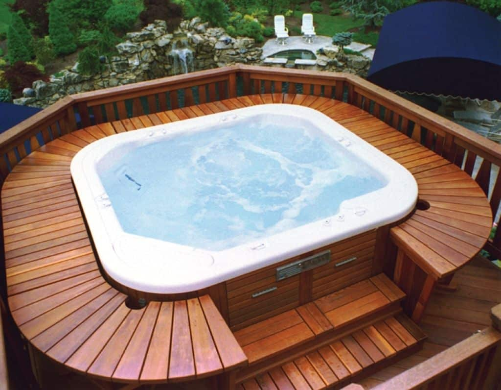 A small hot tub with hardwood decking