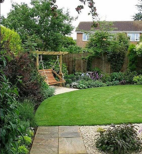 A garden with a small corner swing