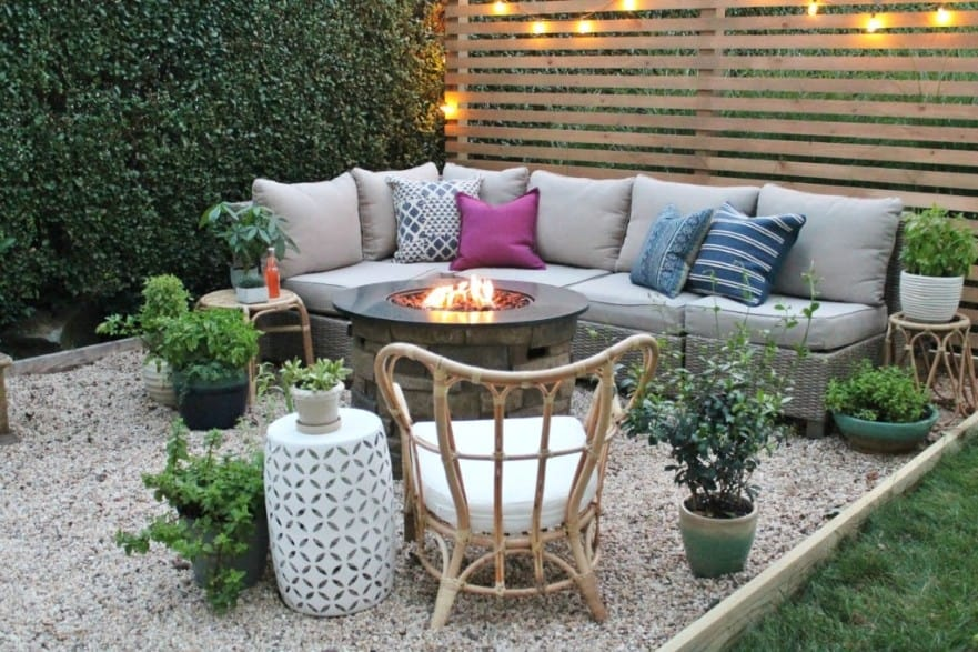 Corner fire pit with a fenced-off patio