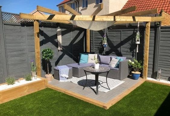 Garden with sleepers and pergola