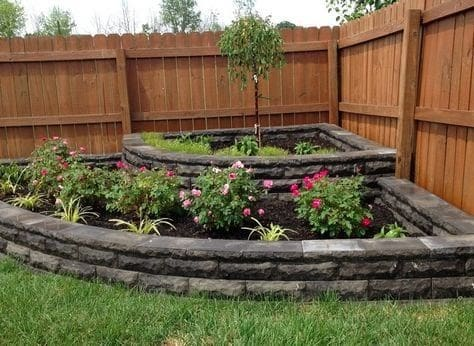 Small corner mini garden with a tiered-style flower bed