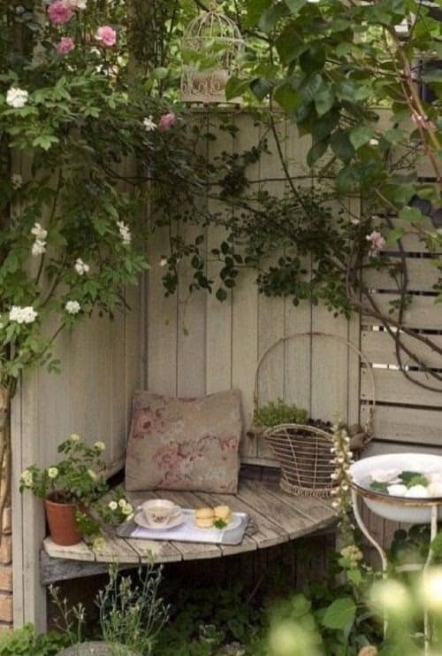 A cosy nook in in the corner with a small seat and cushions