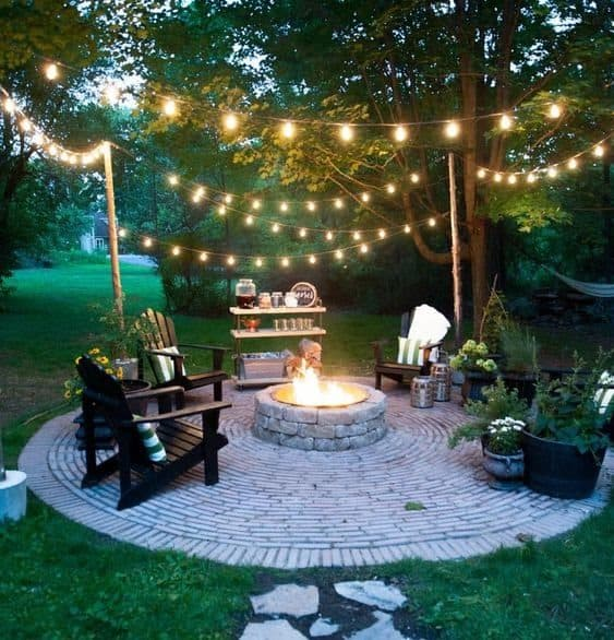 A small outdoor lounge with some comfy seating