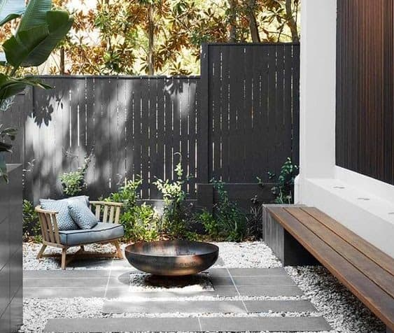 A small seating area with mini fire pit
