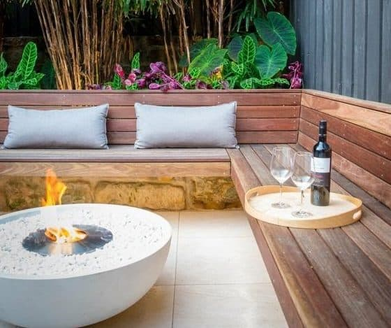A tiny outdoor space with a modern gas fire pit