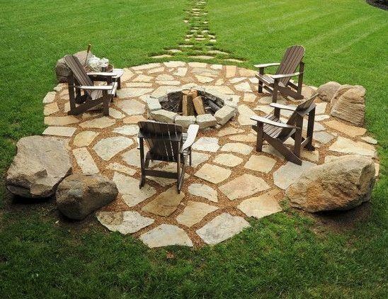 A natural stone patio in the middle dedicated to the fire pit