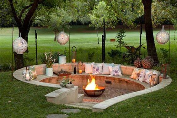A stylish buried fire pit area