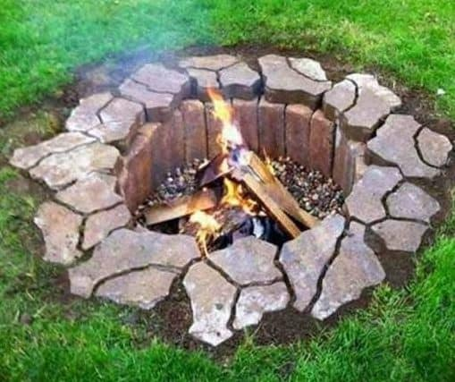 DIY buried fire pit lined with stones