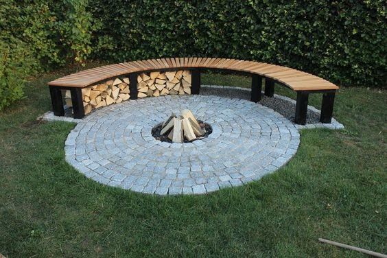 A bench that sits next to a fire pit