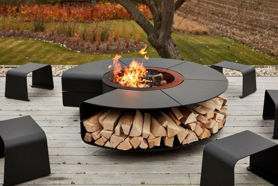Modern black fire pit and small benches